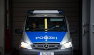 A police car carrying Canadian porn actor Luka Rocco Magnotta leaves the main detention center in Berlin, on June 5. German prosecutors said the Canadian porn star accused of killing and dismembering a Chinese student in Montreal will probably be extradited by the end of the month