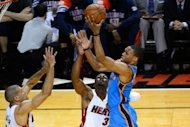 Oklahoma City Thunder's Russell Westbrook (R) oes for a shot next to Miami Heat's Dwyane Wade (C) and Shane Battier in game four of their 2012 NBA Finals on June 19. Westbrook was the catalyst for the Thunder, scoring 17 points in the fourth, including 13 straight points in the final quarter to keep the score close