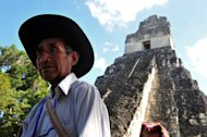 A Guatemalan Maya native visits the Tikal archaeological site on December 20, 2012. The exquisite site of Mayan ruins began hosting winter solstice ceremonies on Thursday as the region's indigenous people marked the end of an era