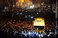 Thousands of people gather on January 16, 2013 as the coffins of the three female Kurdish activists who were killed in Paris last week arrive home in Turkey's southeastern city of Diyarbakir, a Kurdish minority stronghold