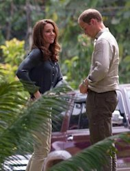 "Britain's Prince William and Catherine, the Duchess of Cambridge, arrive at the Borneo Rainforest Research Center in Danum Valley, on the island of Borneo on September 15. The British royal family have warned an Italian magazine that ""unjustifiable upset"" would be heaped on Catherine if it went ahead and printed topless photos of her."