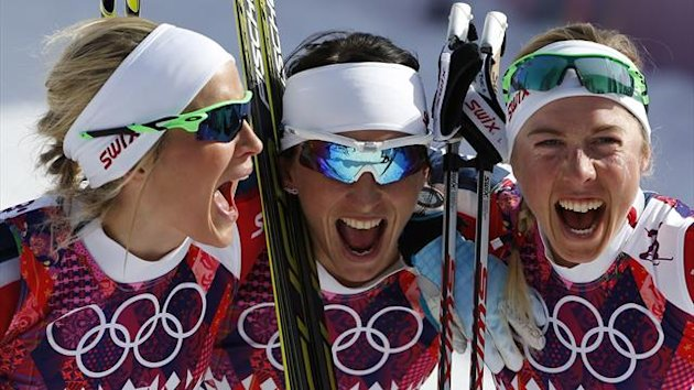 Norway's Therese Johaug, Marit Bjoergen and Kristin Stoermer Steira (L-R) celebrate after crossing the finish line to win the women's cross-country 30 km mass start free event at Sochi 2014 (Reuters)