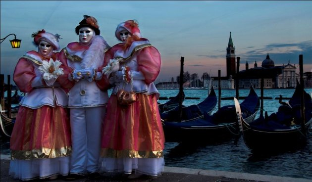 Revellers in costume at the Venice Carnival