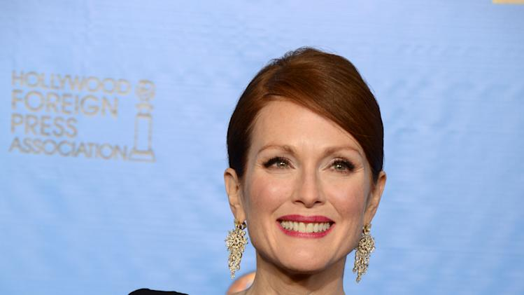 "Julianne Moore poses with the award for best miniseries or motion picture made for television for ""Game Change"" backstage at the 70th Annual Golden Globe Awards at the Beverly Hilton Hotel on Sunday Jan. 13, 2013, in Beverly Hills, Calif. (Photo by Jordan Strauss/Invision/AP)"