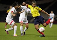 North Korea's Kim Nam Hui (L) and Colombia's Orianica Velasquez during their Olympic women's football opener in Glasgow, Scotland, on July 25. North Korea won 2-0