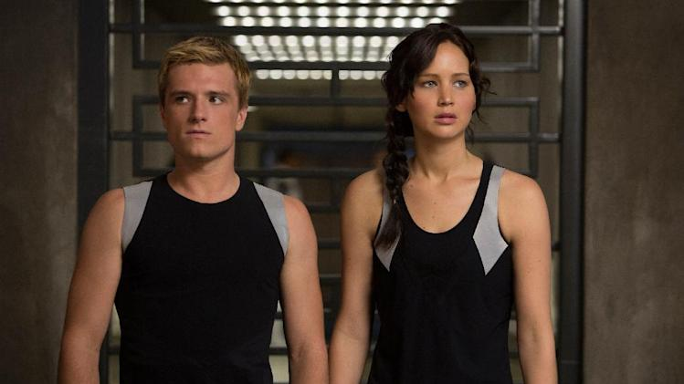 "This image released by Lionsgate shows Josh Hutcherson as Peeta Mellark, left, and Jennifer Lawrence as Katniss Everdeen in a scene from ""The Hunger Games: Catching Fire."" (AP Photo/Lionsgate, Murray Close)"