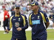 Australia's head coach Mickey Arthur (R) and team captain Michael Clarke, seen here before their 3rd ODI cricket match between England and Australia at The County Ground, Edgbaston in Birmingham, on July 4. Clarke has urged his side to leave England with at least one win after they suffered yet another hammering at the hands of their old foes on Saturday