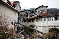 A destroyed building, moved by the tsunami, is seen in Onagawa, Miyagi prefecture. Radiation levels have surged in seawater near a tsunami-stricken nuclear power station in Japan, officials said Saturday, as engineers battled to stabilise the plant in hazardous conditions
