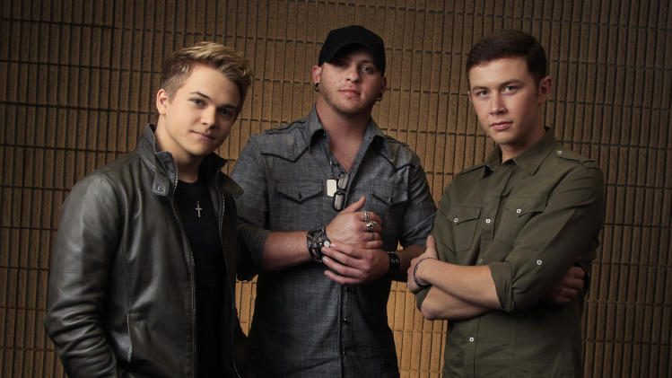 This March 8, 2012 photo shows Hunter Hayes, left, Brantley Gilbert, center, and Scotty McCreery, right, in Nashville, Tenn. The fan-voted top new artist category at the Academy of Country Music Awards features all three. (AP Photo/Mark Humphrey)
