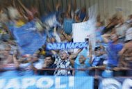 Napoli supporters cheer their team before their Serie A match against Sampdoria in Genova on September 30. Napoli has come under scrutiny after the country's Finance Police raided the club in relation to suspicions of financial foul play, media reports said
