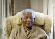 Nelson Mandela in July last year at his home in Qunu, Eastern Cape. South Africa's presidency said that Nelson Mandela is still critically ill in hospital but improving slightly, declining to comment on a report the anti-apartheid hero had undergone an operation
