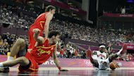 United States' LeBron James picks up a loose ball in front of Spain's Pau Gasol and Rudy Fernandez during a men's gold medal basketball game at the 2012 Summer Olympics, Sunday, Aug. 12, 2012, in London. (AP Photo/Eric Gay)