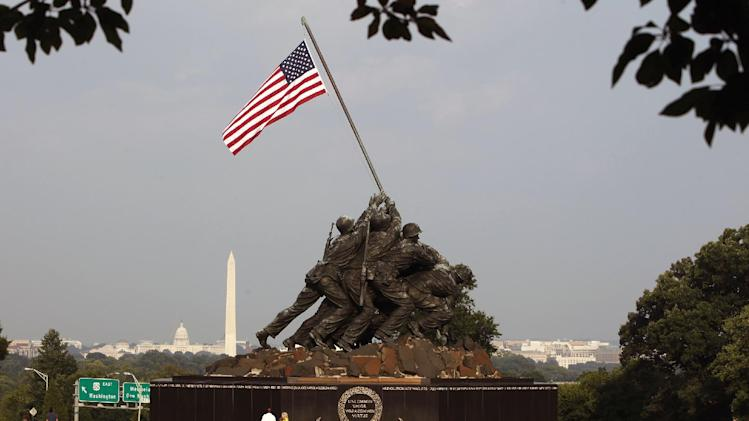 FILE - This is a Sunday, Aug. 9, 2009 file photo of the United States Marine Corps War Memorial, better known as the Iwo Jima Memorial, depicting one of the most historic battles of World War II, at the Arlington, Va. The Sochi Winter Olympics are making Russians beam with pride. But while the opening ceremony left out World War II at the behest of international Olympic organizers, Russia's role in defeating Nazi Germany is still one of the nation's proudest moments, as some have found out the hard way. Because of perceived slights to Russian pride over victory in the war, an independent television station has been forced off the air and the Moscow correspondent of a U.S. network has been summoned to the Foreign Ministry for an official reprimand. In the latest display of Russian displeasure, a prominent anchor on state television suggested the U.S. Marines depicted in the war memorial near Washington were gay. (AP Photo/Ron Edmonds, File)