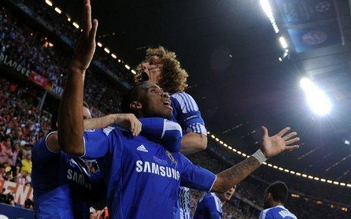 Chelsea's Didier Drogba celebrates with teammates after scoring against Bayern