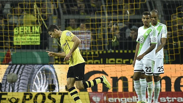 Dortmund's Robert Lewandowski of Poland, left, celebrates after scoring during the semifinal match of the German soccer cup between Borussia Dortmund and VfL Wolfsburg in Dortmund , Germany, Tuesday, April 15, 2014