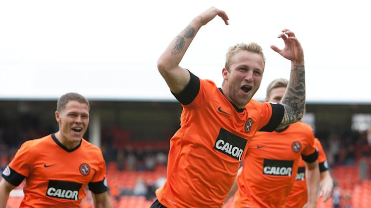 Johnny Russell, front, was on target for Dundee United against Queen of the South