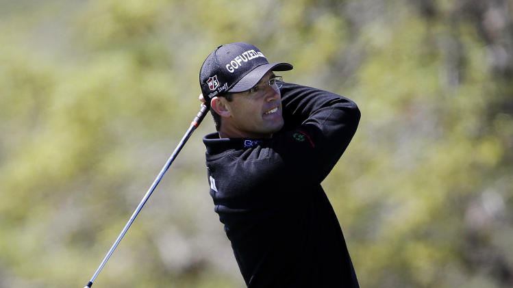 Padraig Harrington, of Ireland, watches his approach shot on the 18th hole during the first round of the Texas Open golf tournament, Thursday, April 4, 2013, in San Antonio.  (AP Photo/Eric Gay)