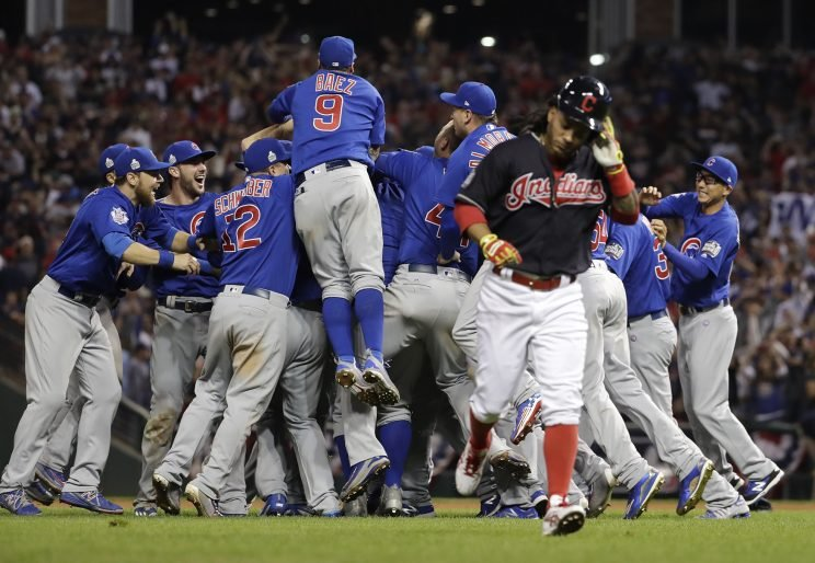 Chicago Cubs celebrate after Game 7 of the Major League Baseball World Series against the Cleveland Indians, Nov. 3, 2016, in Cleveland. The Cubs won 8-7 in 10 innings to win the series 4-3. (Photo: Matt Slocum/AP)