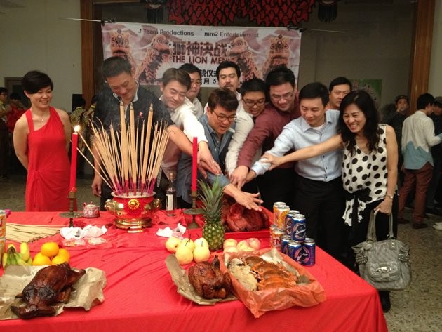 "The opening ceremony for ""The Lion Men"" was laced with much fanfare--with Neo and his executive producers and crew collectively slicing a large suckling pig. (Yahoo! photo)"