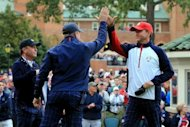 USA team captain Davis Love III (R) greets his assistants Scott Verplank (C) and Jeff Sluman on the first tee during the Morning Foursome Matches for The 39th Ryder Cup at Medinah Country Club, on September 28, in Medinah, Illinois