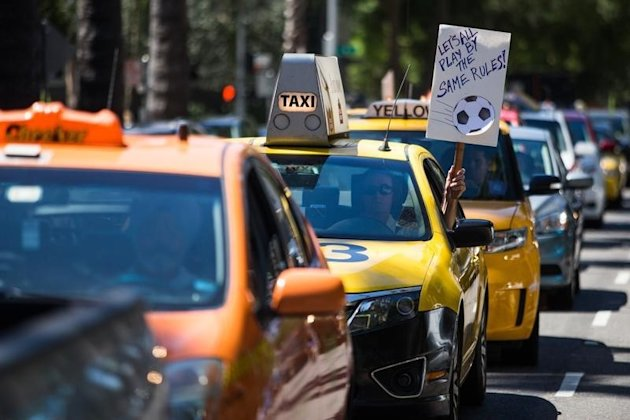 Taxi drivers protest against Uber in Sacramento, California, June 25, 2014. REUTERS/Max Whittaker