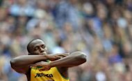 Jamaica's Usain Bolt gestures before the men's 200m heats at the athletics event during the London 2012 Olympic Games on August 7, in London