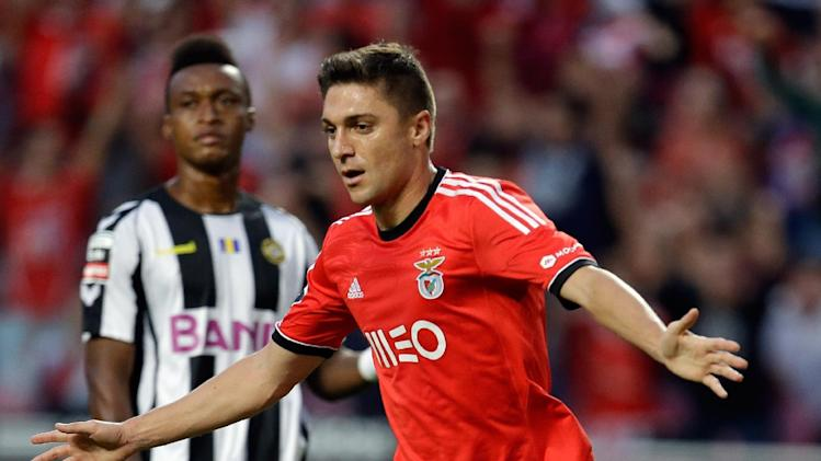 Benfica's Siqueira celebrates after scoring the opening goal  during their Portuguese league soccer match with Nacional Sunday, Oct. 27 2013, at Benfica's Luz stadium in Lisbon