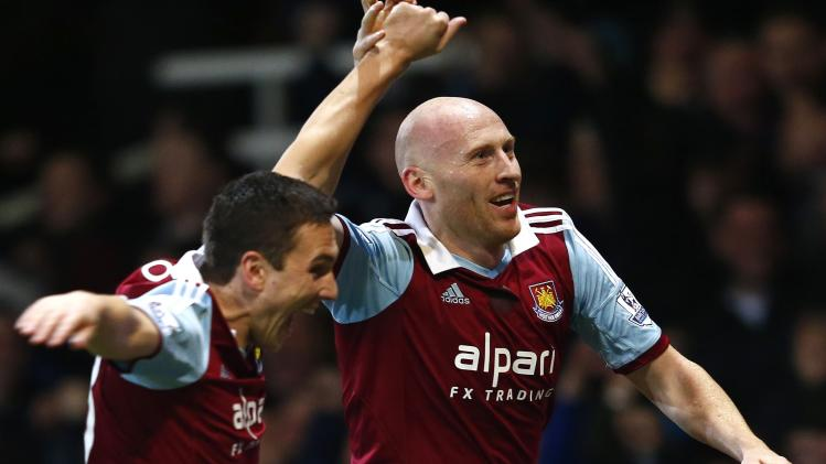 West Ham United's Collins celebrates with team mate Borriello after scoring a goal against Norwich City during their English Premier League soccer match at the Boleyn Ground in London