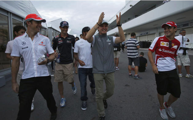 Drivers walk after the second practice session of the Japanese F1 Grand Prix at the Suzuka circuit