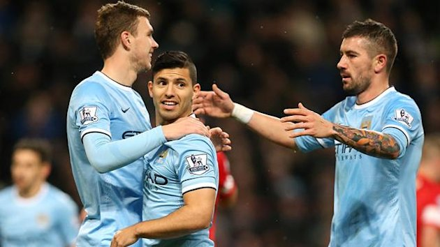 Manchester City's Sergio Aguero (centre) celebrates scoring their fourth goal of the game with team-mates Edin Dzeko and Aleksandar Kolarov (right)