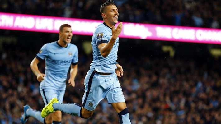 Manchester City's Stevan Jovetic (front) celebrates after scoring a goal against Liverpool during their English Premier League soccer match at the Eti...