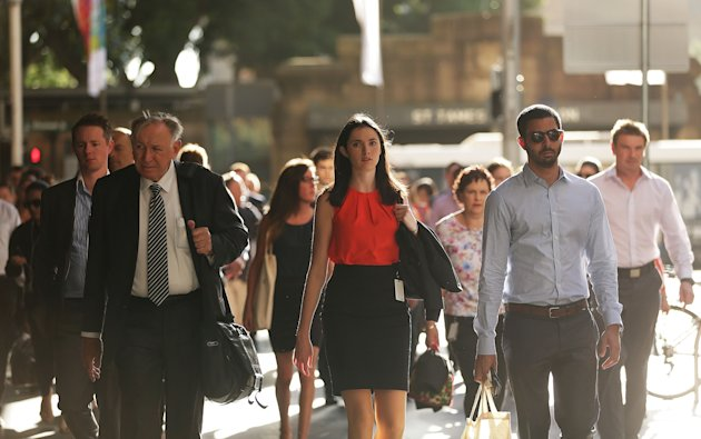 People walk from St James station on their journey to work December 16, 2014 in Sydney. (Getty Images)
