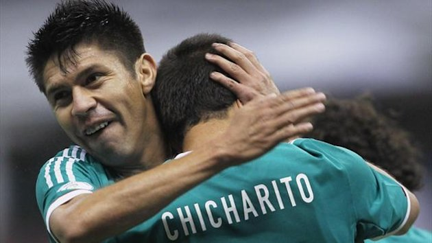 Javier Hernandez (R) of Mexico celebrates his goal with team mate Oribe Peralta during their 2014 World Cup qualifying soccer match against Costa Rica (Reuters)
