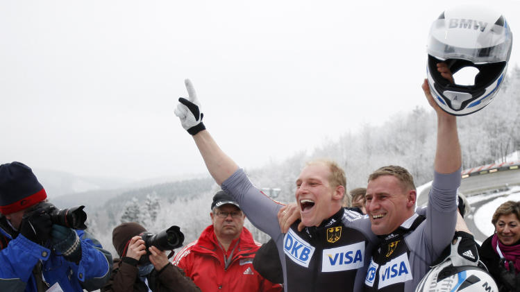 Germany's Karl Angerer, right, and Alex Mann celebrate coming in third at the two-man bob eventat the Bobsleigh World Cup in Winterberg, Germany, Saturday, Jan. 22, 2011.   (AP Photo/Frank Augstein)