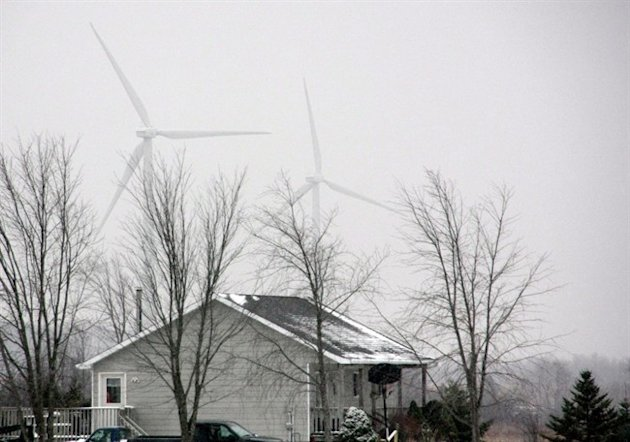 Wind turbines are seen near a home in Melancthon Township, Ont., on Sunday, Nov. 16, 2014. THE CANADIAN PRESS/Colin Perkel