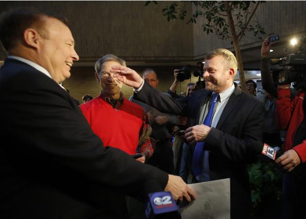 Utah state senator Dabakis is married to his partner Justesen by Salt Lake City Mayor Becker at the Salt Lake County office building in Salt Lake City, Utah