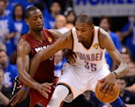 Oklahoma City Thunder's Kevin Durant (R) and Miami Heat's Dwyane Wade during game one of the NBA Finals on June 12. Durant scored 23 of his game-high 36 points in the second half