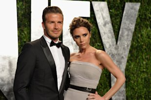 David Beckham and fashion designer Victoria Beckham arrive at the 2012 Vanity Fair Oscar Party