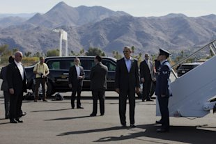 President Obama grins on the tarmac at Palm Springs International Airport in February 2014.