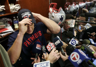 Rob Gronkowski shows off another AFC East title cap last December. (AP)