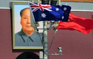 File picture shows the national flags of Australia and China displayed before a portrait of Mao Zedong in Beijing in April 2011. Chinese hackers have stolen top-secret blueprints of Australia's new intelligence agency headquarters, a report said Tuesday, but Foreign Minister Bob Carr insisted ties with Beijing would not be hurt