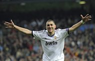 Real Madrid's French forward Karim Benzema celebrates after scoring during the UEFA Champions League quarter-final first leg football match Real Madrid vs Galatasaray on April 3, 2013 at the Santiago Bernabeu stadium in Madrid. Real won 3-0