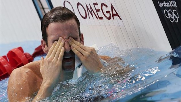 Australia's James Magnussen wipes his eyes after winning silver in the men's 100m freestyle final during the London 2012 Olympic Games at the Aquatics Centre