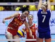 This file photo shows a Chinese player spiking the ball past a Polish competitor during their match at the FIVB 2010 Women's Volleyball World Championships in Tokyo. Experts say China has Olympic medal chances in taekwondo, judo, women's water polo, women's volleyball, women's beach volleyball and trampoline, in which they have numerous world champions