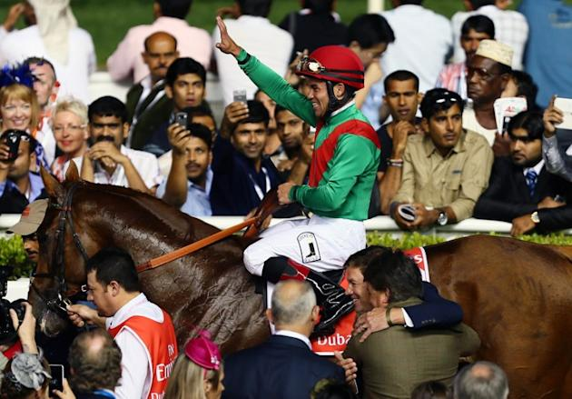 Jockey Joel Rosario jubilates after leading Animal Kingdom to win the 10 million US dollar Dubai World Cup, the world's richest race, at Meydan race track in Dubai  March 30, 2013. The 2011 Kentucky D