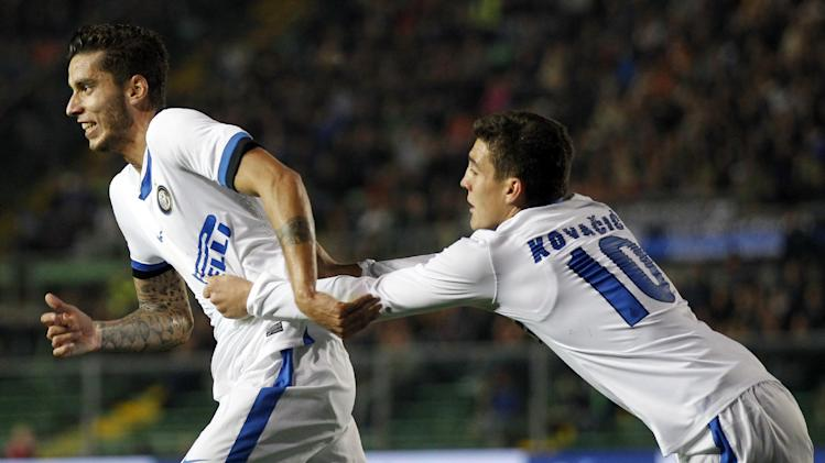 Inter Milan's Ricardo Alvarez, left, of Argentina, is congratulated by teammate Mateo Kovacic after he scored during a Serie A soccer match against Atalanta in Bergamo, Italy, Tuesday, Oct. 29, 2013