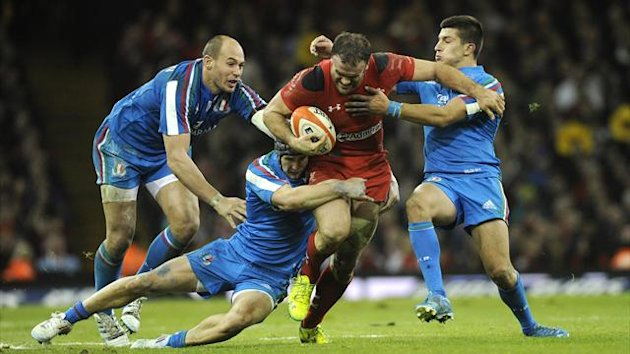 Wales' Jamie Roberts (C) is tackled by Italy's Sergio Parisse, Michele Campagnaro and Tommaso Allan, during their Six Nations clash (Reuters)