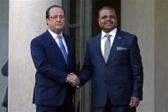 France's President Francois Hollande (L) greets Prime Minister of the Central African Republic Nicolas Tiangaye in the courtyard of the Elysee Palace at the start of the Elysee Summit for Peace and Security in Africa, in Paris, December 6, 2013. REUTERS/Benoit Tessier