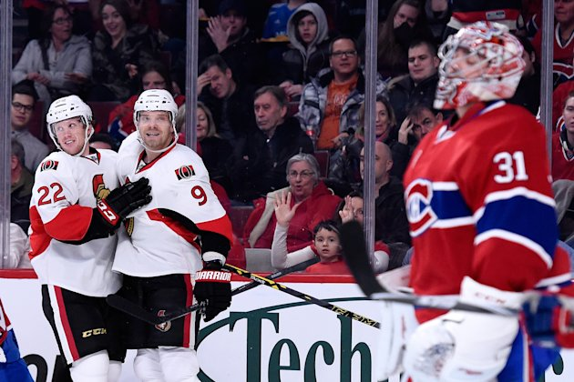 The Senators celebrate a first period goal against the Canadiens on December 20, 2014. (Photo by Richard Wolowicz/Getty Images)
