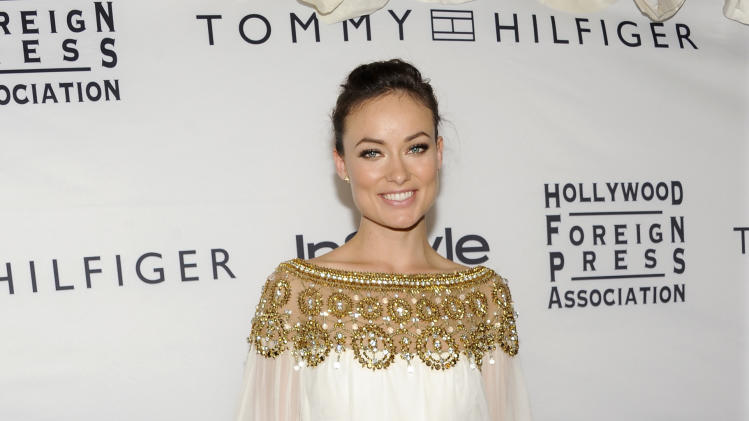 Actress Olivia Wilde attends the Instyle and Hollywood Foreign Press party at the Windsor Arms Hotel during the Toronto International Film Festival on Tuesday, Sept. 13, 2011 in Toronto. (AP Photo/Evan Agostini)